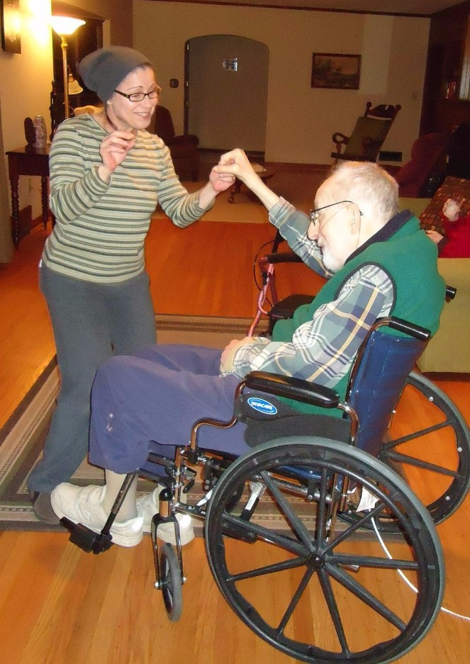 Caregiver dancing with resident